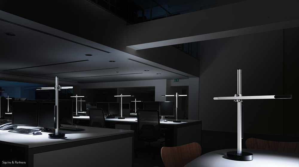 A dark empty office highlighting the high level of illumination of the CSYS task light.